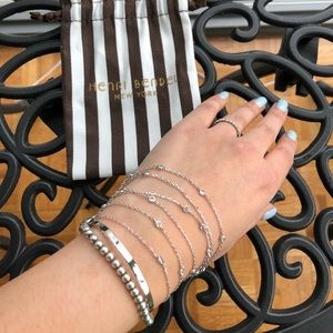 Henri Bendel cuff bracelet with layers.